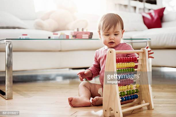 Baby Girl playing with wooden toys