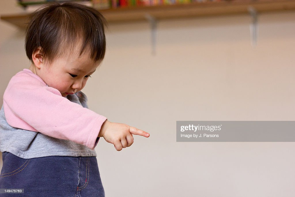 Baby girl pointing : Stock Photo