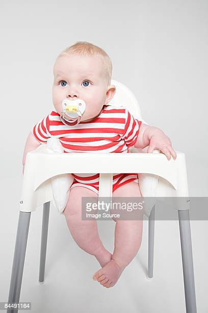 A baby girl sat in a high chair