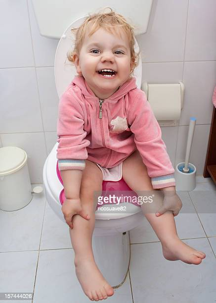 Baby girl sitting in the bath