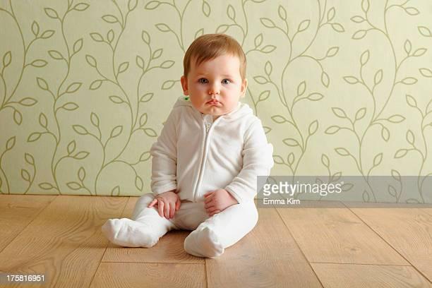 Baby girl sitting on floor