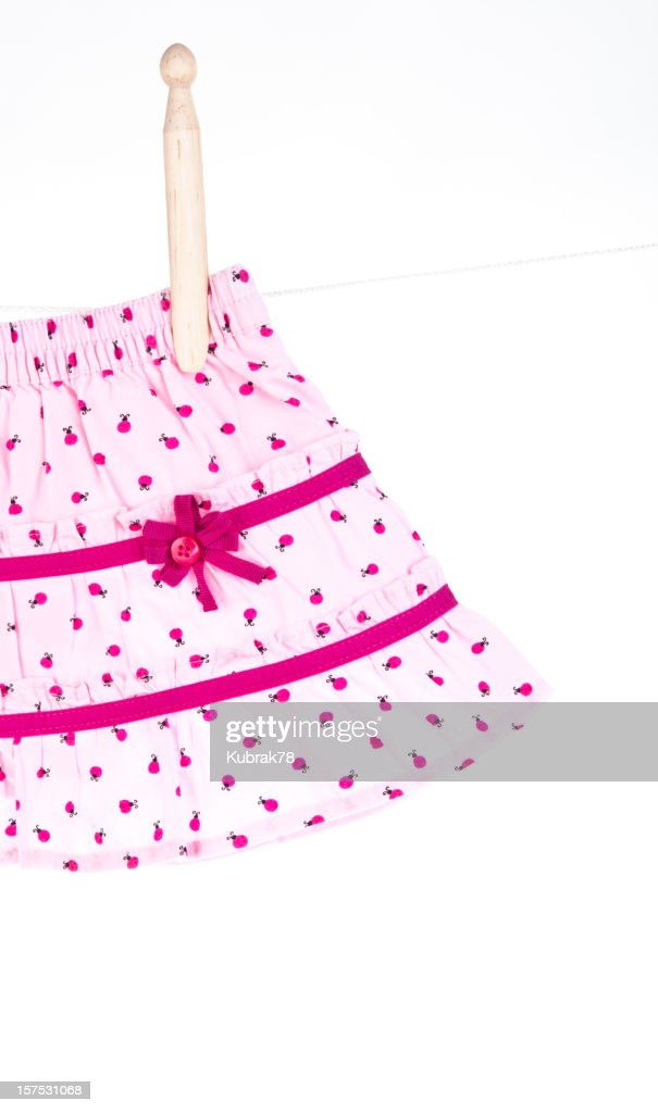 Baby girl skirt hanging on a clothesline : Stock Photo
