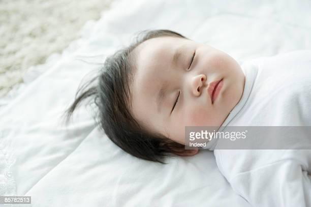 Baby girl sleeping, high angle view