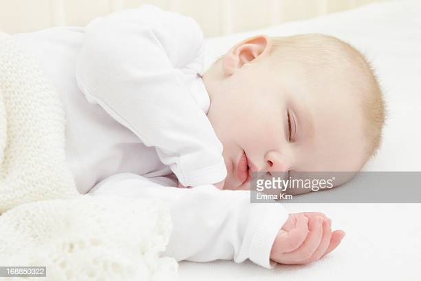 Baby girl sleeping in crib