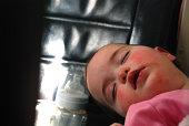 Baby girl sleeping on airplane