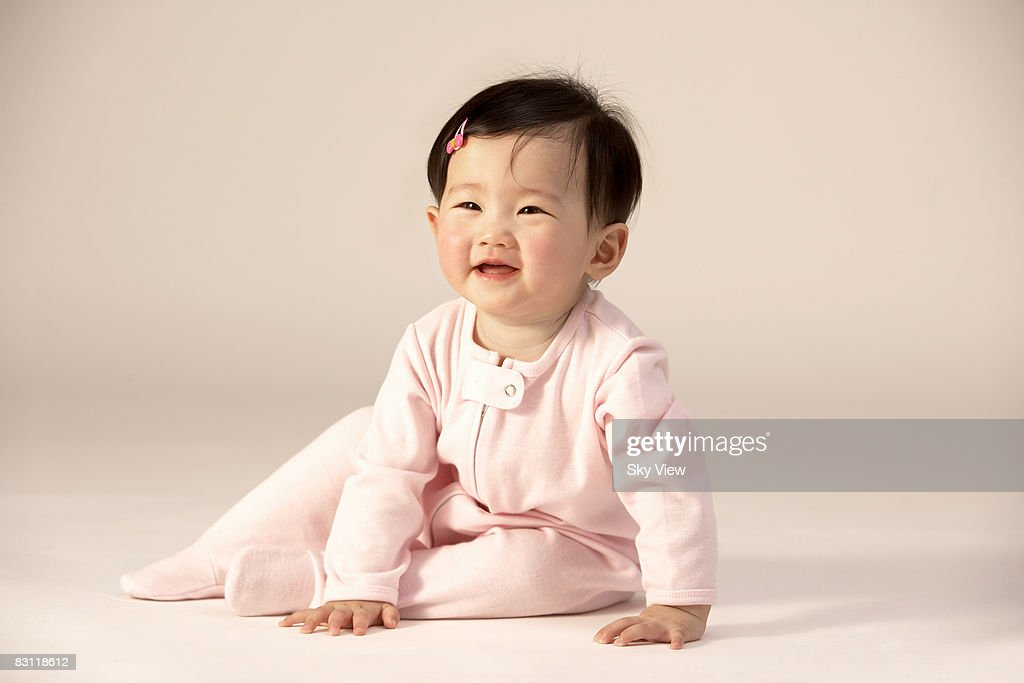 Baby girl (6-9 months) smiling