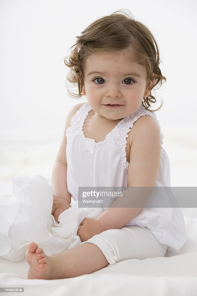 Baby girl smiling, portrait : Stock Photo