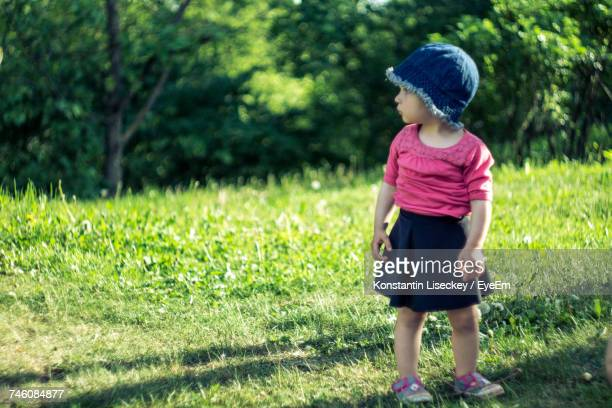 Baby Girl Standing On Grass At Park
