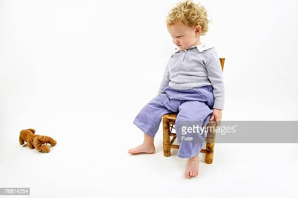 Baby Girl Throwing Stuffed Animal