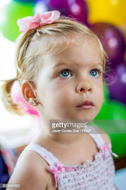 Baby girl watching a parade in a party