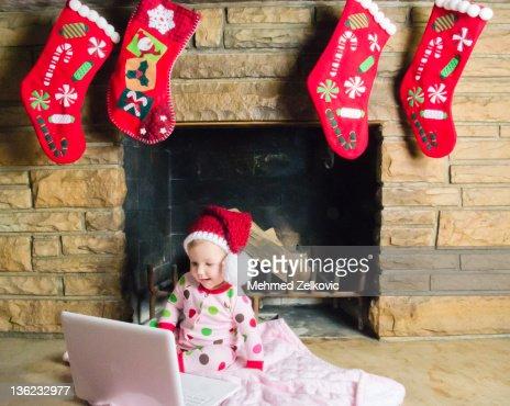 Baby girl wearing santa hat : ストックフォト