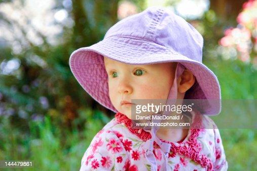 Baby girl wearing sunhat : Stock Photo