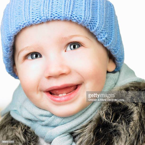 Baby girl with a hat, smiling