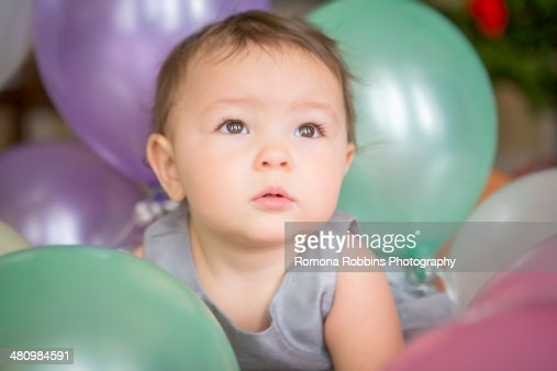 Baby girl with balloons : Stock Photo