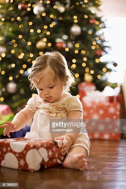Baby girl with Christmas gift