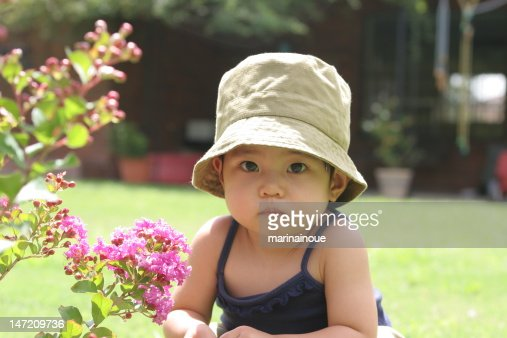 Baby girl with flower : Stock Photo