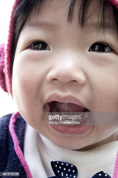 Baby girl with little teeth