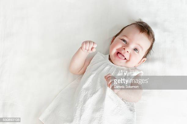 Baby girl with white dress on white background