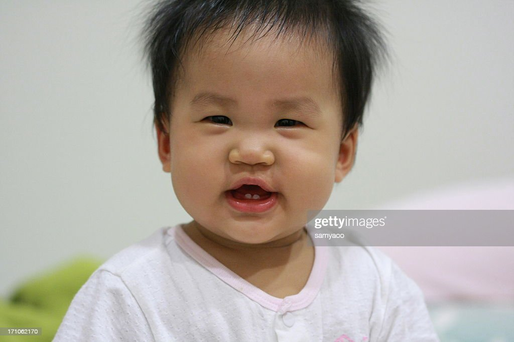 Baby girl's close-up : Stock Photo