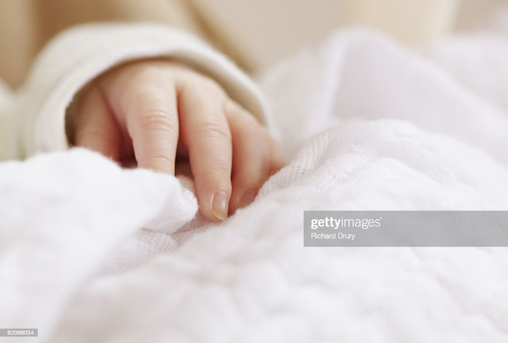 Baby girl's hand close-up : Stock Photo