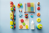 Baby Goods: Wooden Toy, Milk Bottle, Pacifier and Teething Ring Still Life