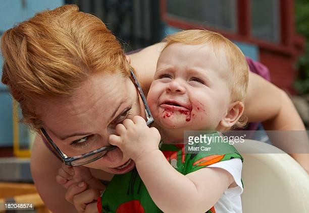 Baby grabbing mom's glasses