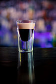 Shot glass with Kahlua coffee liqueur flavor. With  Irish cream on top.