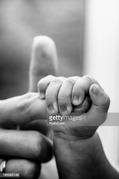 Baby Hand Holding Mothers Finger