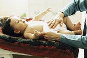 Baby having diaper changed