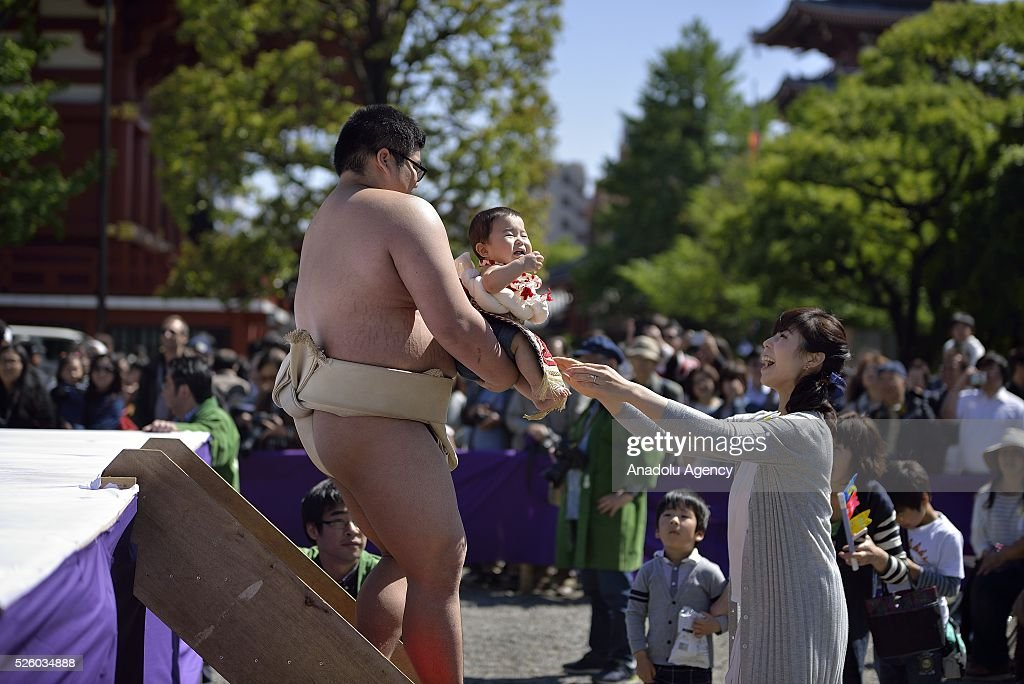 A baby, held by a sumo wrestler, cries during the Nakizumo or crying baby sumo contest at Sensoji Temple on April 29, 2016 in Tokyo, Japan. Babies compete crying at this traditional festival which is believed to bring growth and good health to the infants.