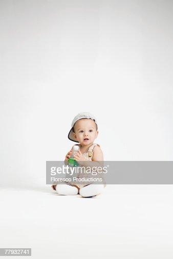 Baby holding bottle of water : Stock Photo