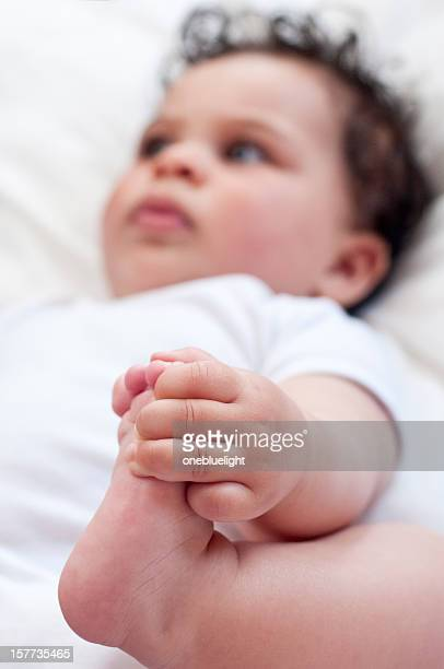 Baby (5-6 months old) Holding Her Foot With One Hand