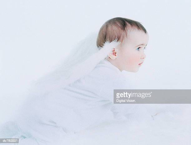 Baby in a Romper Suit With Angel's Wings