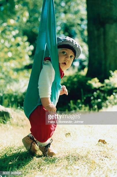 Baby in Bouncer in Garden
