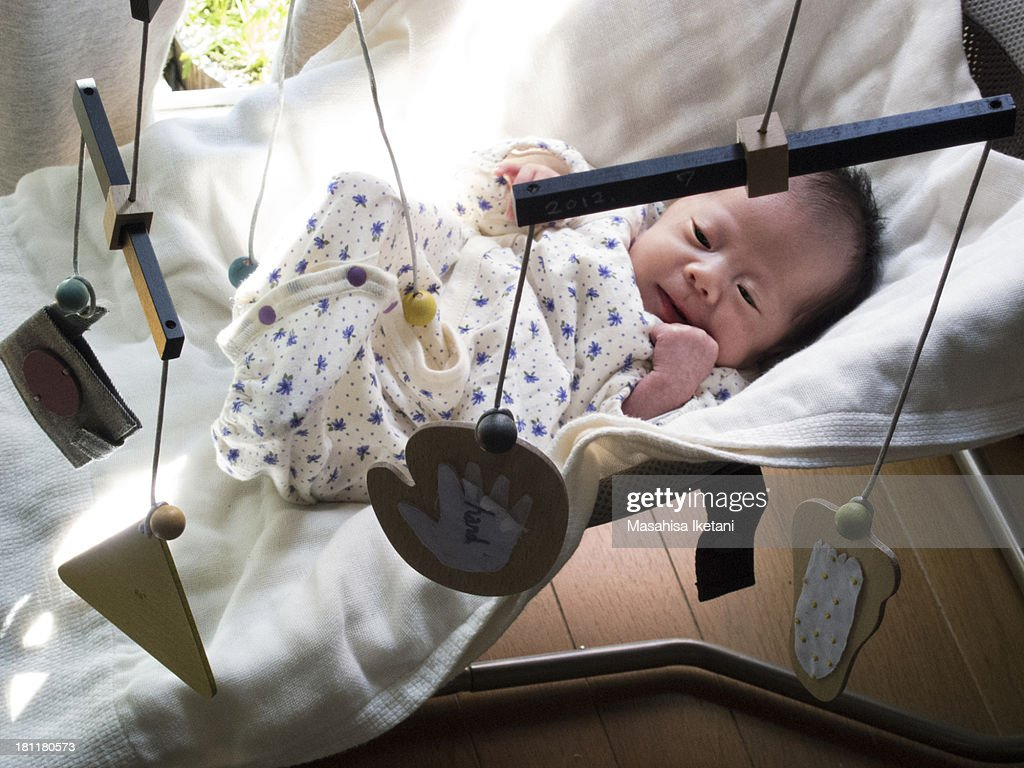 Baby in Cot : Stock Photo