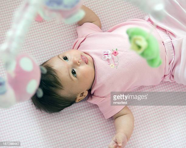 Baby in crib with mobile