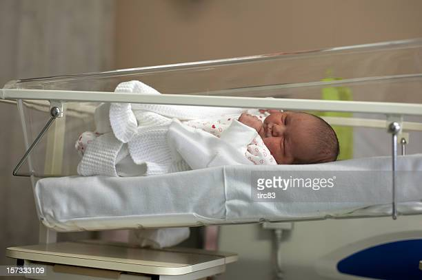 Baby in maternity ward cot full length