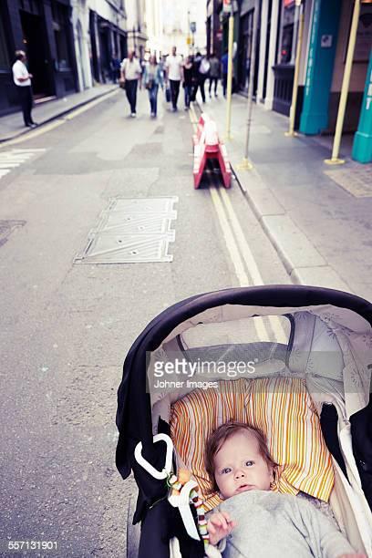 Baby in pram on street