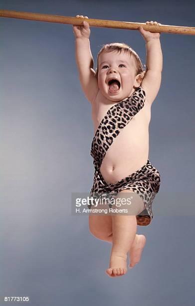 Baby In Tarzan Leopard Skin Costume Hanging Swinging From Tree Limb Yelling.