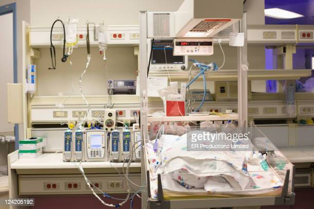 Baby in warming bassinet in hospital