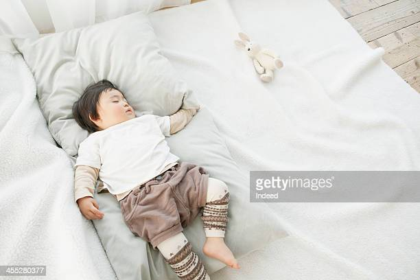 Baby is sleeping with stuffed animal