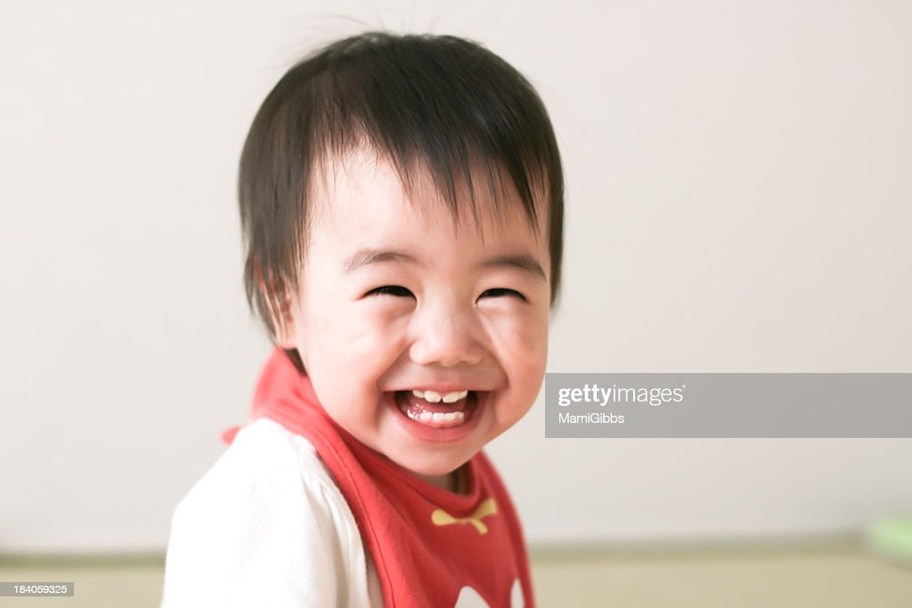 Baby is smiling : Stock Photo
