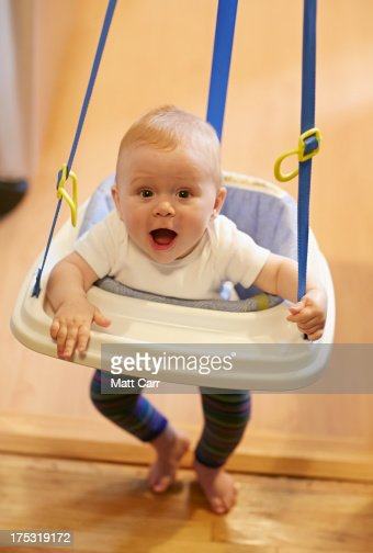 Baby jumping on jumper : Stock Photo
