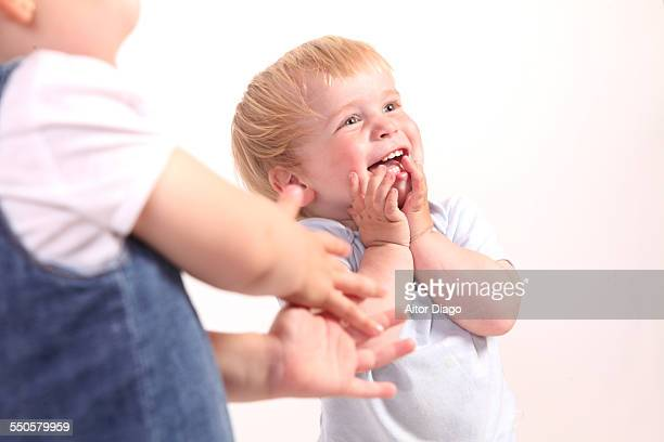 Baby laughing out loud.