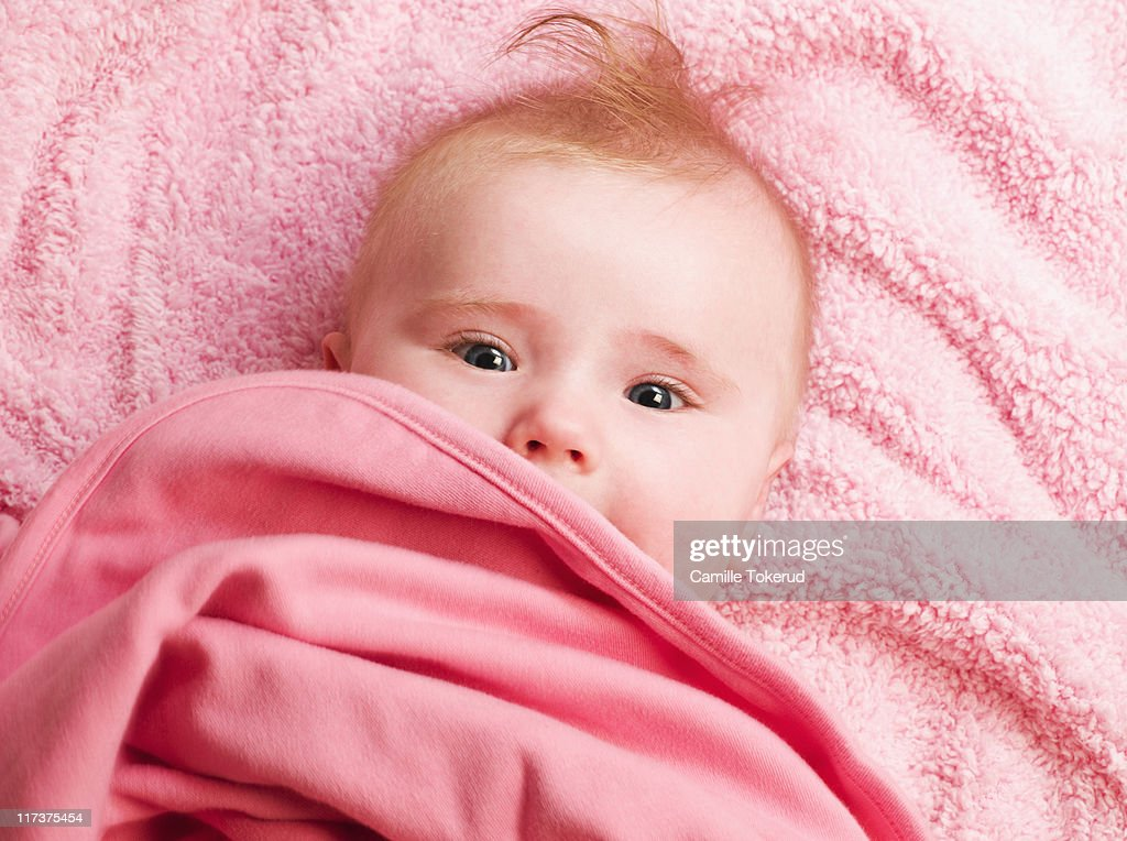 Baby laying on bed : Stock Photo