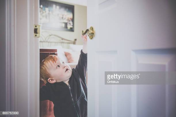 Baby Learning to Open a Door