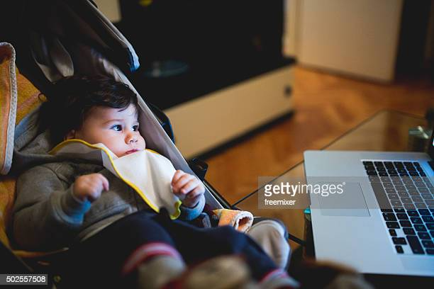 Baby looking at cartoon on laptop