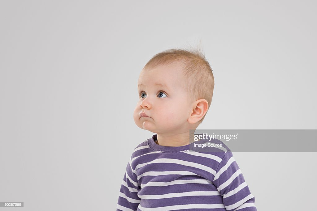 Baby looking up : Stock Photo