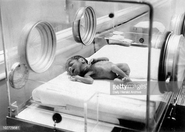Baby lying in oxygen tent February 1956 'Baby arrives unexpectedly Sleeping peacefully in her incubator at St Mary's hospital Manchester tonight is...
