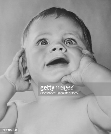 Baby making funny face : Stock Photo